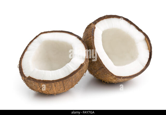 the halved coconut on white background - Stock Image