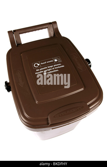 A Brown food waste recycling dustbin against a white background - Stock Image