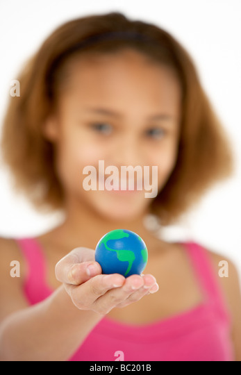 Young Girl Hoiding Small Globe - Stock-Bilder