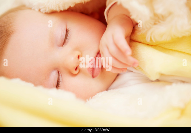 Baby in peaceful slumber - Stock Image