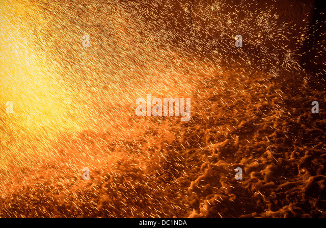 Impact of molten metal poured on water in steel foundry - Stock Image