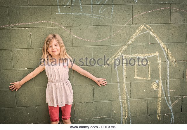Girl in front of wall with chalk drawings, portrait - Stock-Bilder