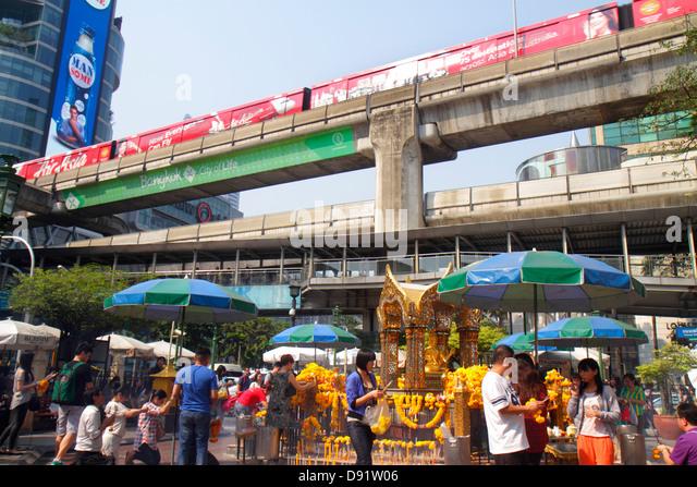 Bangkok Thailand Pathum Wan Ratchadamri CentralWorld Plaza Erawan Shrine Hindu statue Phra Phrom Brahma religion - Stock Image
