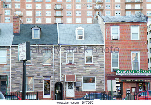 Baltimore Maryland Little Italy ethnic neighborhood row house brick Formstone mixed use Colombo Bank business contrast - Stock Image
