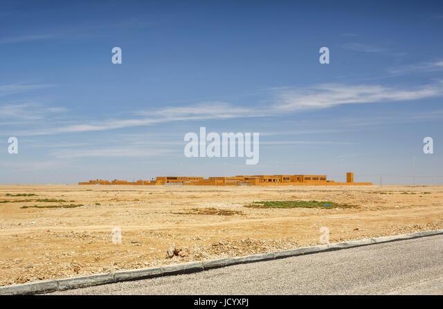 Distant view towards campus. Laayoune Technology School, Laayoune, Morocco. Architect: Saad El Kabbaj, Driss Kettani, - Stock-Bilder