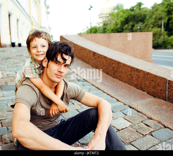 Young father hipster and his little son outside. Talking, teachi - Stock Image