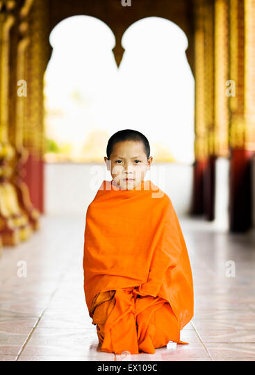 A portrait of a 12-year-old novice monk at Wat Manoran.  Luang Prabang, Laos - Stock Image