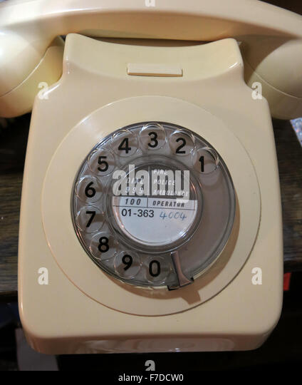 Cream GPO telephone type 746 with 01 London number on rotary dial, UK - Stock Image