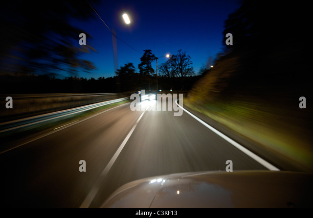 View of road from car at night - Stock Image