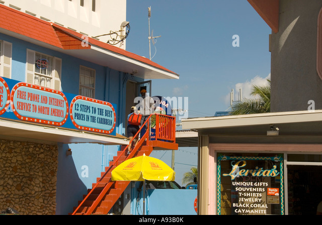George Town Grand Cayman colorful store stairs tourists - Stock Image