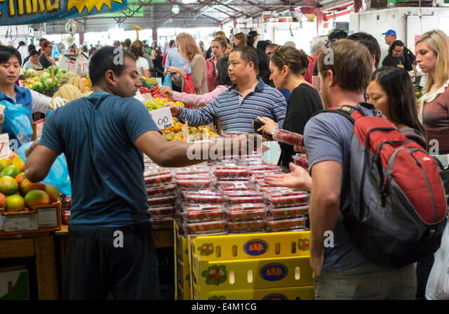 Melbourne Australia Victoria Central Business District CBD Queen Victoria Market vendor stall selling buying sale - Stock Image
