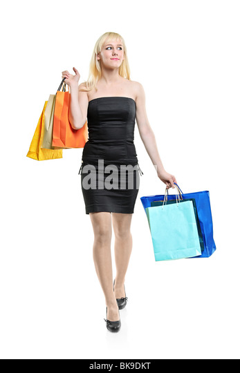 A young female coming back from shopping - Stock Image