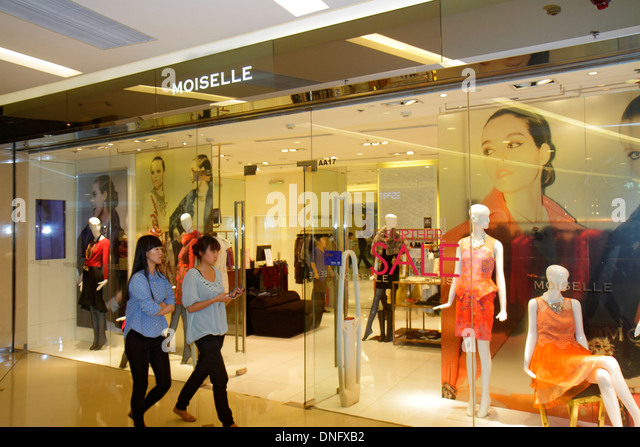 Beijing China The Malls at Oriental Plaza shopping store entrance front Asian woman women's clothing fashion - Stock Image