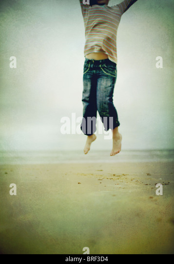 girl jumping in the air - Stock Image