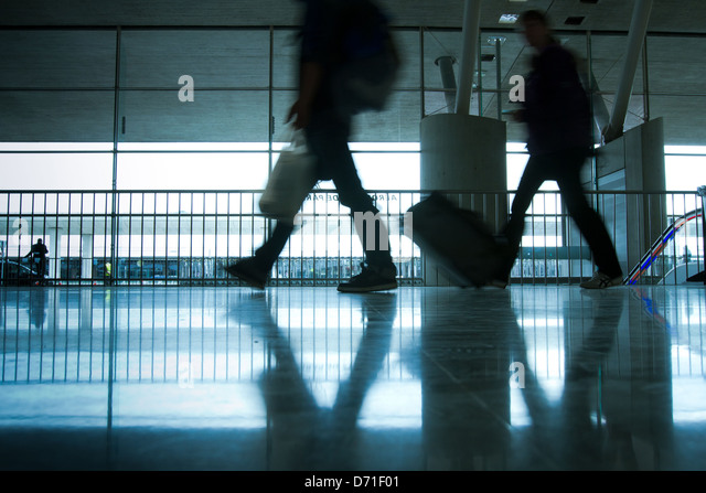 abstract airport and silhouette of people walking with luggage - Stock Image