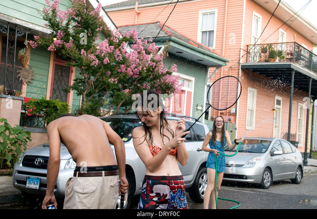 Residents of the Bywater neighbourhood of New Orleans, playing informal street badminton and having fun, Louisiana. - Stock Image