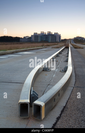 Cambridge guided busway track road and crash barriers leading towards Addenbrookes Hospital - Stock Image