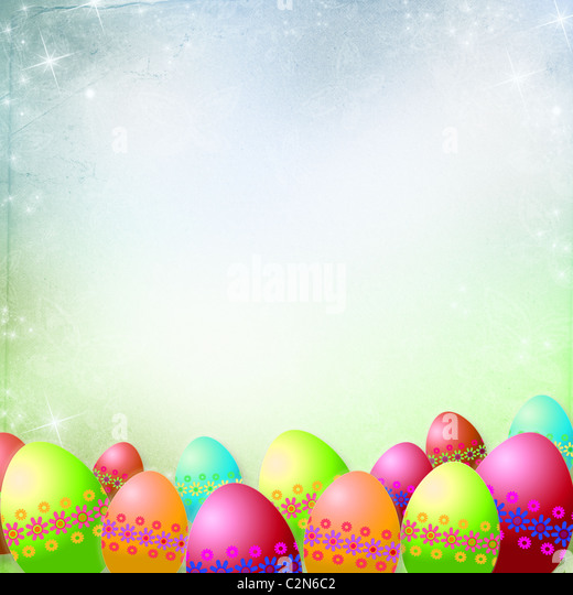 Spring or Easter background with Colorful easter eggs and flowers hanging on ribbons - Stock Image
