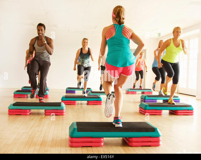 Group of People at Step Aerobics Class - Stock Image