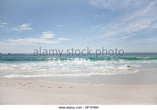 Surf along beach - Stock Image