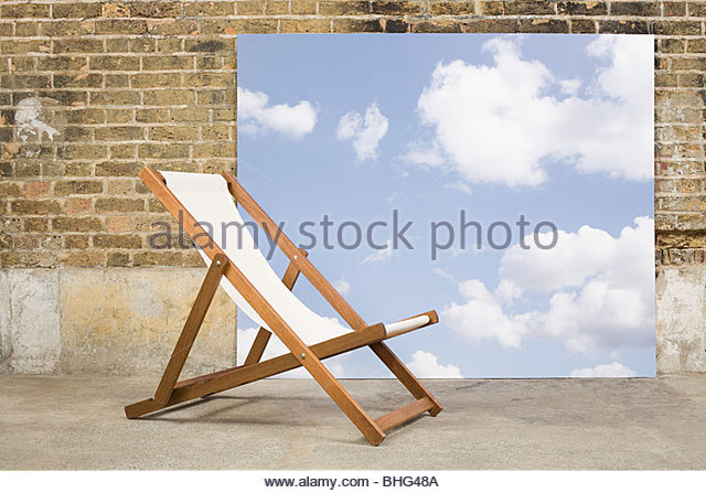 Deckchair and sky backdrop - Stock Image