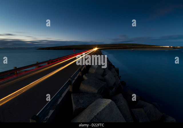 Light trails on Churchill Barriers - Stock Image
