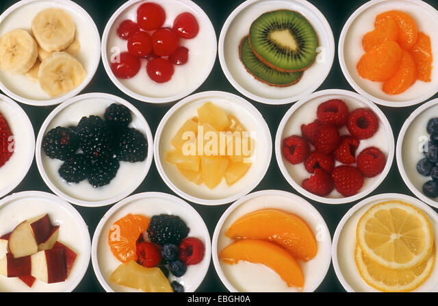 Variety of Fresh Fruit and Yogurt - Stock Image