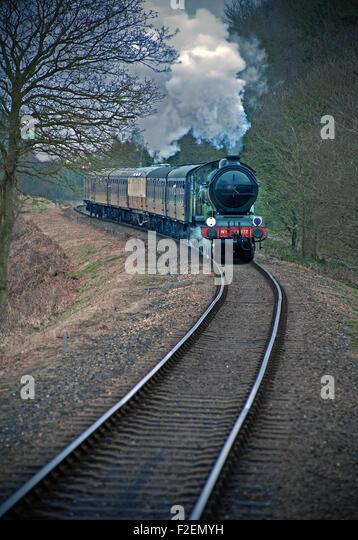 steaming railway train - Stock Image