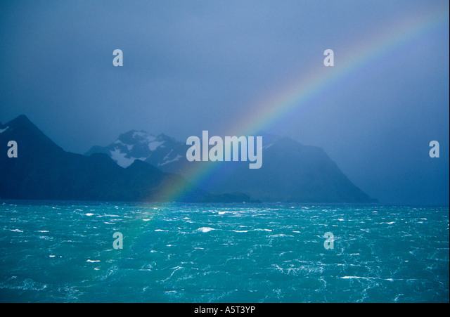 Rainbow over South Georgia Island Subantarctic - Stock Image