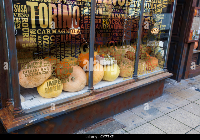 Pumpkins in a shop window in Warwick, UK, for Halloween. - Stock Image
