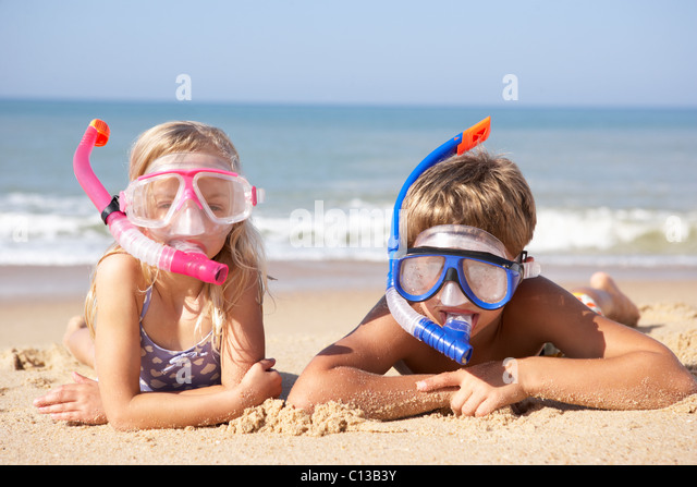 Young children on beach holiday - Stock Image