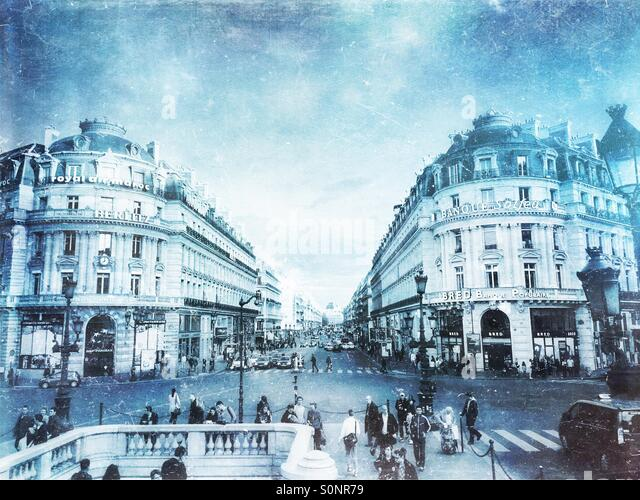 View of street intersection with classical architecture along Les Grands Boulevards in Paris, France. Frosty, winter - Stock Image