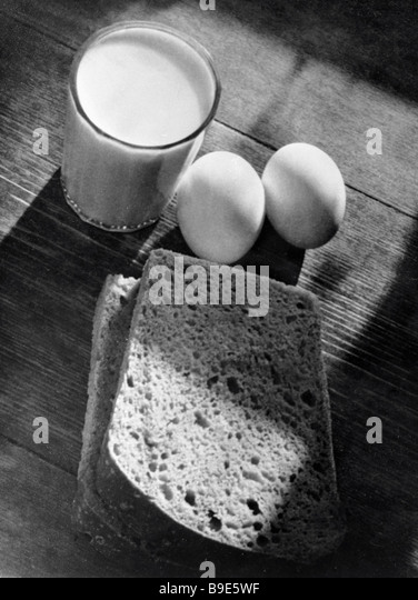 An everyday still life of eggs bread and milk - Stock Image