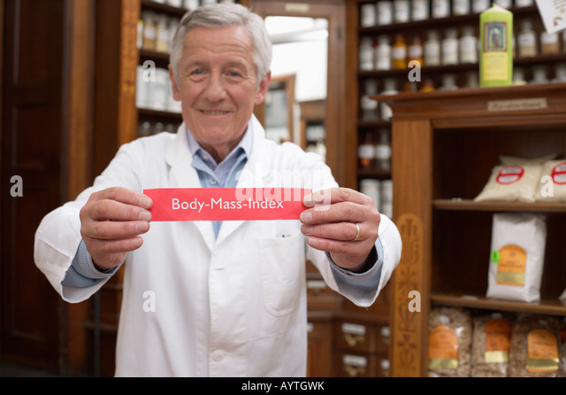 Pharmacist holding body mass index sign - Stock Image