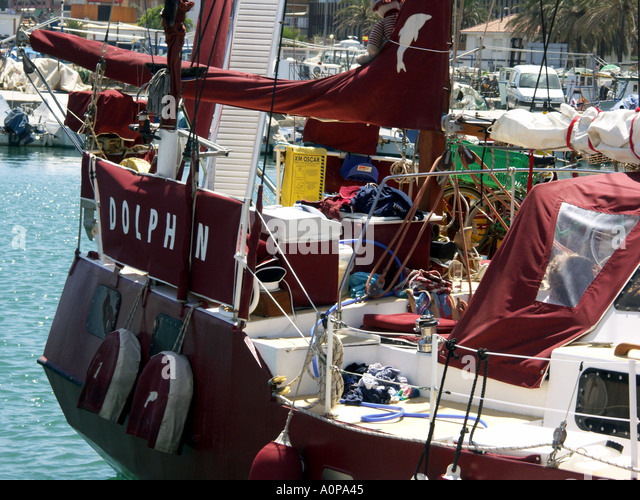 Sailing Boat Dolphin in Fuengirola Port Costa del Sol Spain - Stock Image