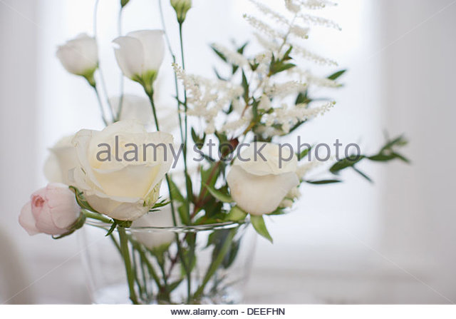 Close up of Flowers in vase on table - Stock Image
