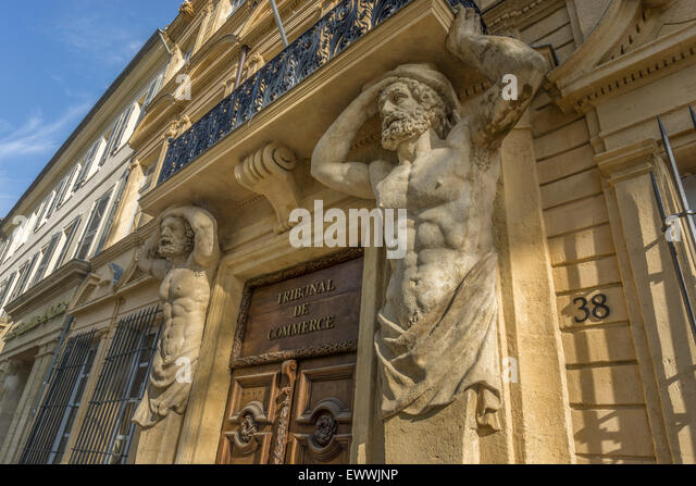 Dorway with caryatids, Tribunal de Commerce, Atlas Figures,   Cours Mirabeau, Aix-en-Provence, Bouches-du-Rhone - Stock Image