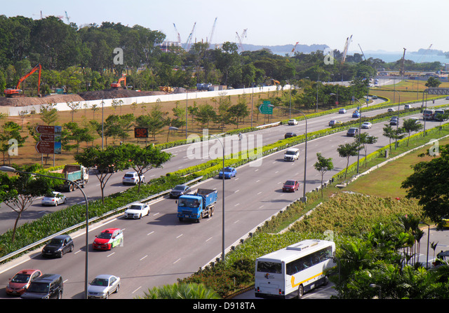 Singapore East Coast Parkway highway traffic ECP cars vehicles - Stock Image