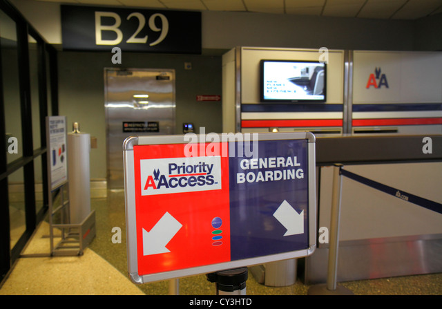 Massachusetts Boston Logan International Airport BOS gate area sign general boarding priority American Airlines - Stock Image