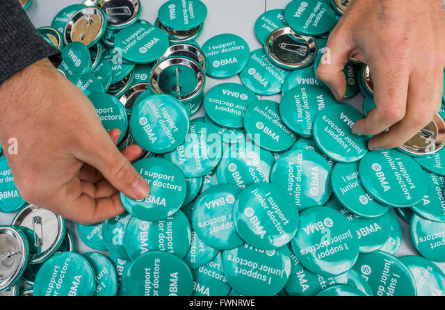 Whitehall, London, UK. 6th April, 2016. Campaign badges - Nurses and doctors march on the department of health in - Stock Image