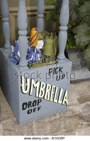 Arkansas Eureka Springs free umbrella city street drop off pick up service convenience trust share honor system - Stock Image