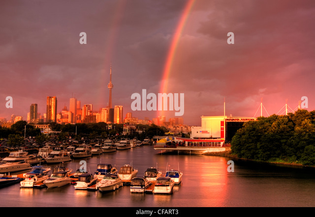 Boats in marina after storm with rainbow, Toronto, Ontario, Canada - Stock Image
