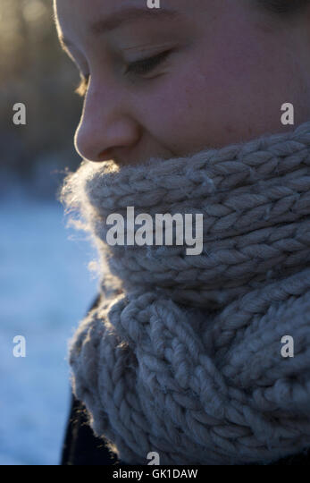 woman wearing knitted scarf. winter, face, cold, woollen. - Stock-Bilder