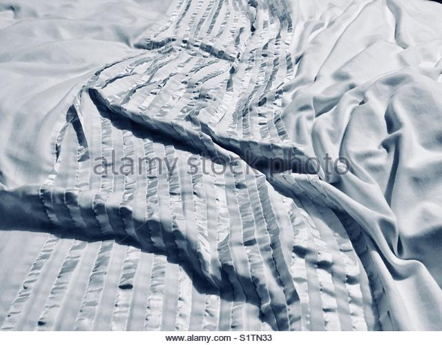 Crumpled bed sheet - Stock Image