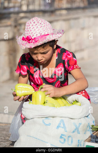 Young girl selling peppers Samarkand market, Samarqand Province, Uzbekistan - Stock Image