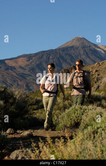 Hikers in front of Mount Teide, Teide National Park, Tenerife, Canary Islands, Spain, Europe - Stock Image