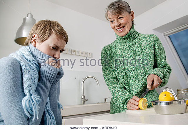 Mother caring for ill daughter - Stock Image