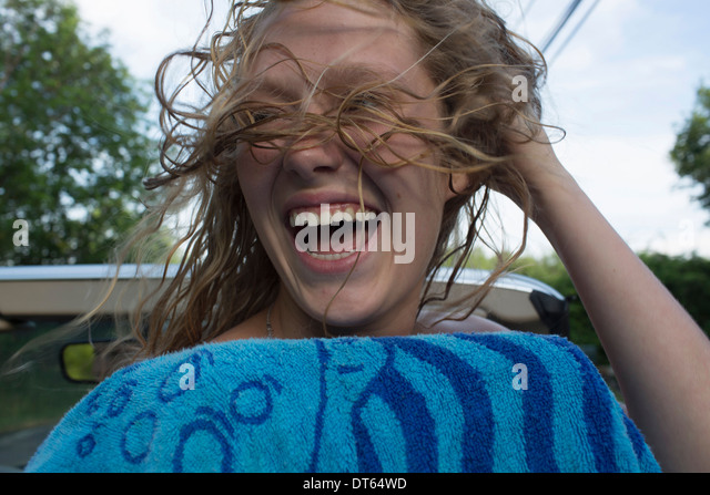 Teenage girl expressing happiness and freedom - Stock Image