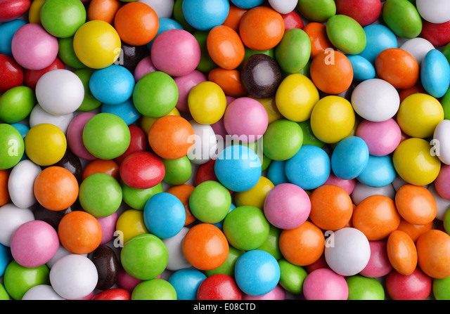 Background of colorful candy drops - Stock Image