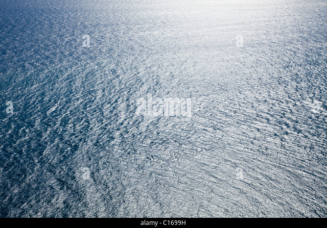 Abstract view of the Atlantic Ocean looking down from the cliffs beside the lighthouse El Faro de la Entallada on - Stock Image